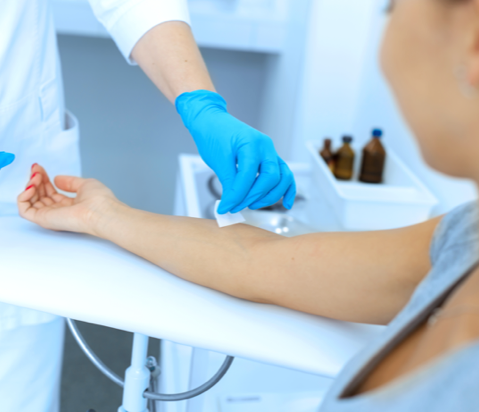 doctor putting alcohol swab on arm